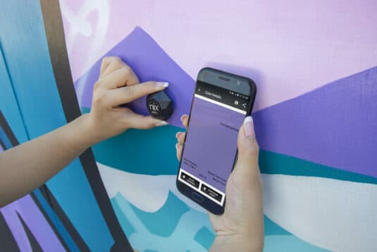Scanning purple wall