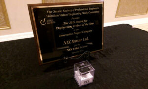 A plaque from the Ontario Society of Professional Engineers presents the 2016 Award for the Engineering Project of the Year to Nix Sensor Ltd.