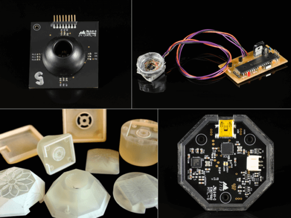 A circuit board, 3D printed prototyping bits, and electronic arts forma collage