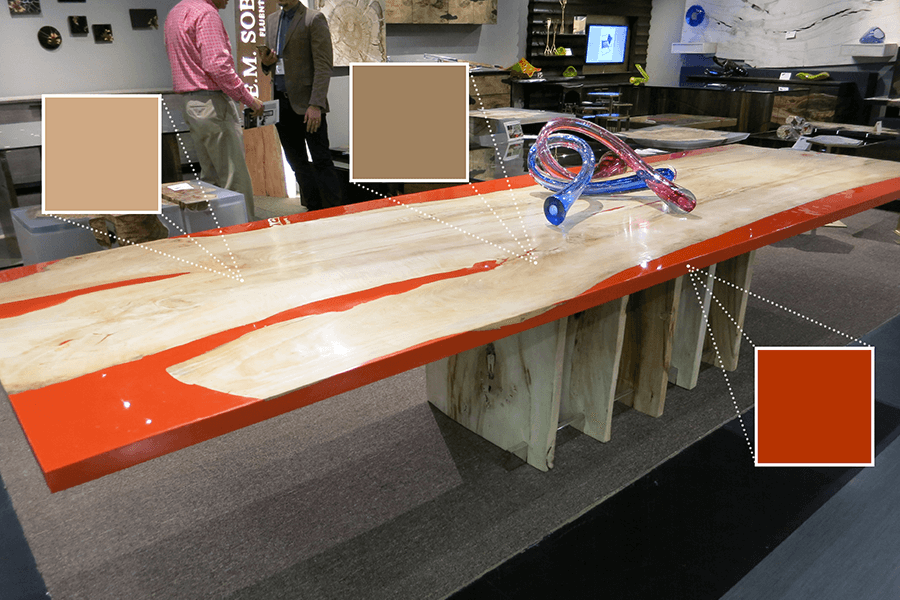 Em Soberon featured one of their beautiful dining tables. This one shows the bright orange epoxy and live-edge wood.
