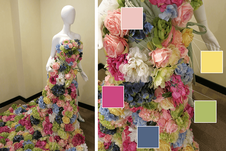 A dress made out of silk flowers featured a rainbow of colors like blue, pink, yellow, and green