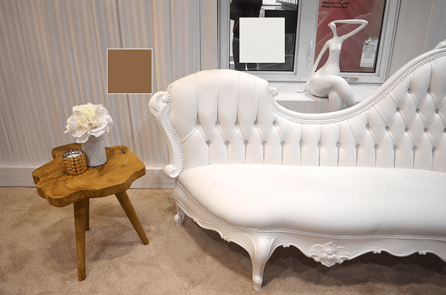 NettHaus' gorgeous white couch paired with a wooden side table