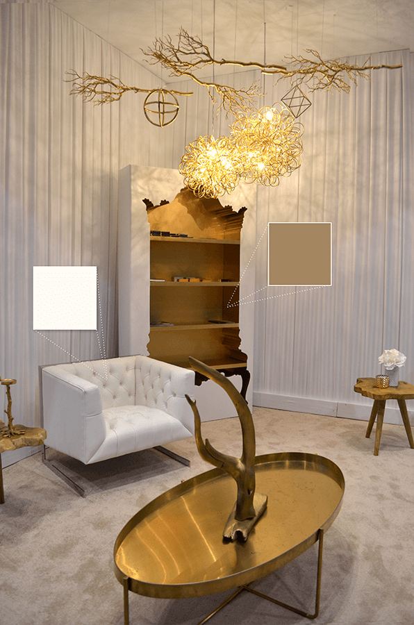 NettHaus' ornate bookshelf featuring warm golds and clean white