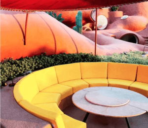 Yellow seating at Antti Lovag 1970's bubble house by Odile Decq