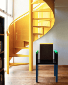 """Yellow stairwell """"The Archers"""" featuring the Palace Chair by George Sowden for Memphis Milano"""