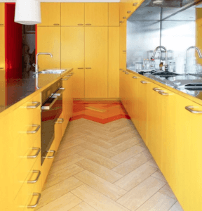 Kitchen apartment with yellow interiors