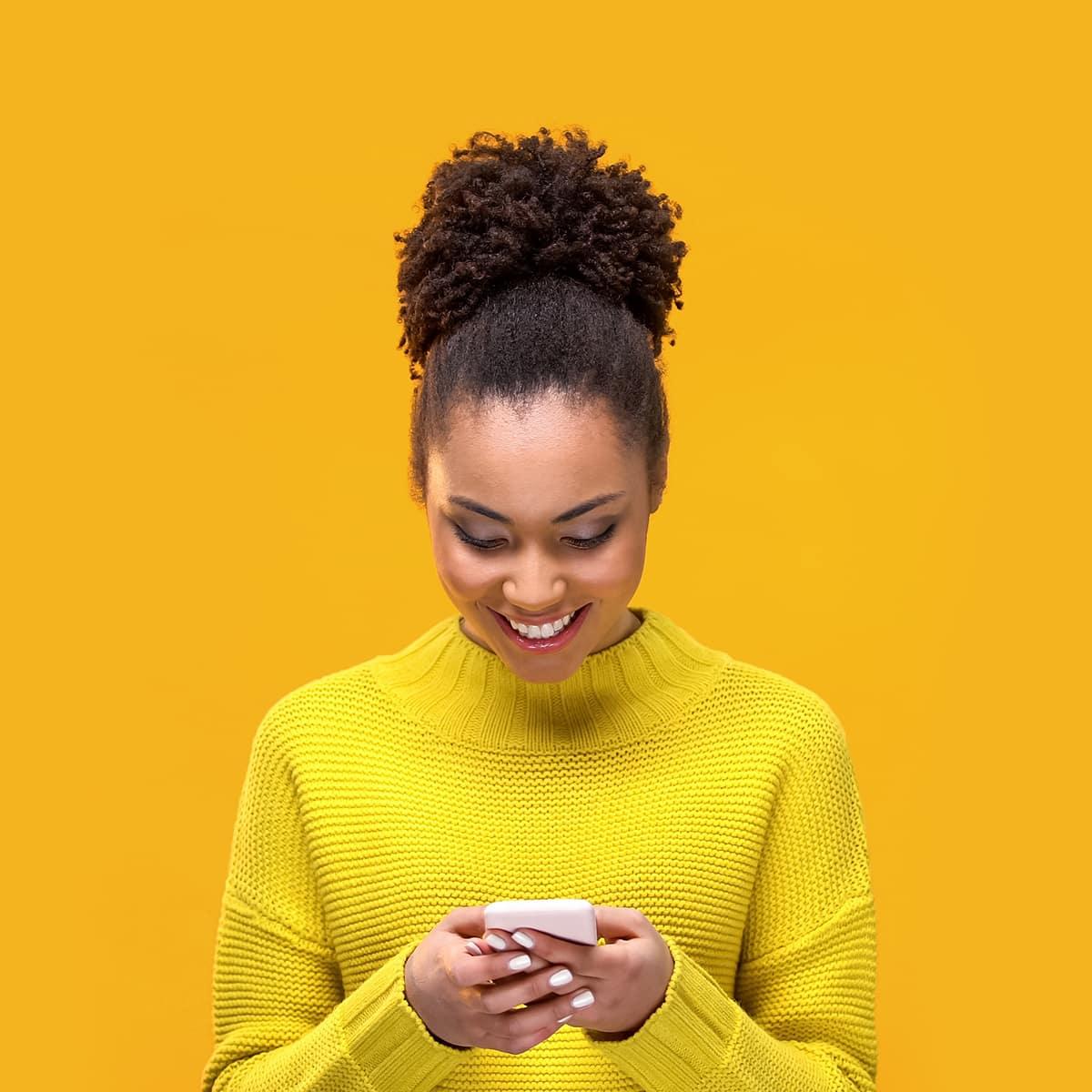 Woman looks at phone screen